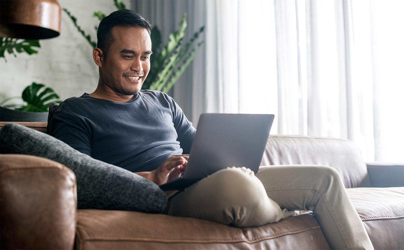 man at home using his laptop